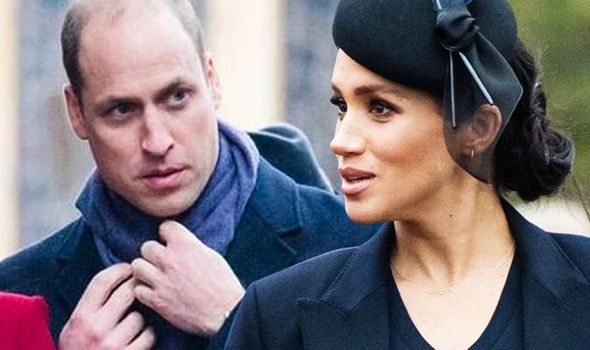 In the video William fiddled with his scarf and appeared to ignore Meghan Image GETTY