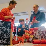 Its beginning to feel a lot like Christmas Prince William got involved in making some festive crackers with children during the bash at the Kensington Palace orangery