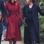Kate and Meghan appeared deep in conversation and Meghans baby bump could be seen in her black dress