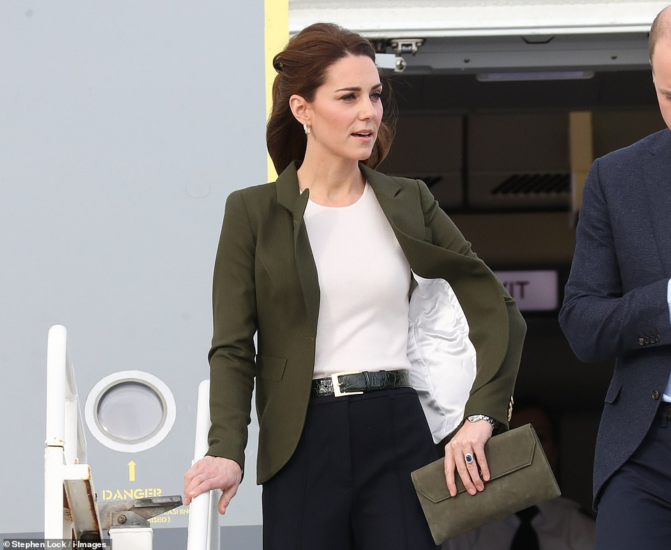 Kate looked elegantly casual in wide legged trousers a white silk shirt and a khaki jacket with her hair half swept off her face