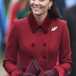 Kate looked stylish in a ruby red coat with a matching hat and gloves Image PA