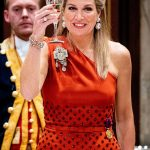 Maxima put on a vibrant display in the satin Claes Iversen dress which featured an asymmetric neckline and was embellished with delicate studs
