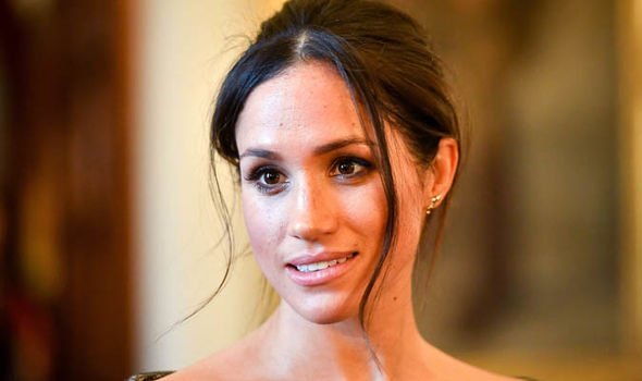 Meghan Markle has been advised to seek the Queens advice to resolve the feud with Kate Image GETTY