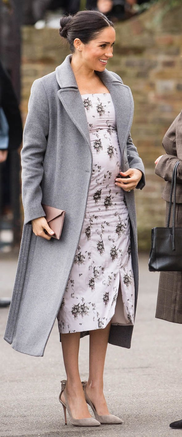 Meghan Markle news Meghan is carrying her bump quite high on her body Image Getty