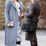 Meghan dressed in a £834 printed dress and £544 Soia and Kyo Adelaida grey wool coat Image GETTY