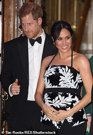 A glowing Meghan Markle was pictured holding her stomach as she attended The Fashion Awards at Londons Royal Albert Hall on Monday evening