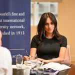 Meghan takes notes at Kings College London Photo The ACU