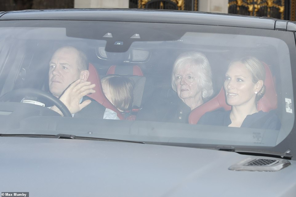 Mike and Zara Tindall pictured in the front seats arrived with daughter Mia Grace just seen in the back