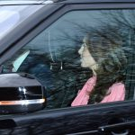 Pretty in pink The Duchess of Cambridge donned a candy coloured dress with pussy bow detailing for the Christmas meal