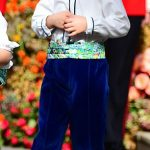 Prince George wore long blue velvet trousers to Princess Eugenies wedding in October
