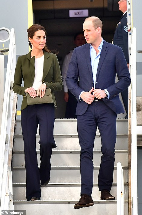 Prince William and Kate smile as they arrive for their official visit to RAF Akrotiri in Cyprus this afternoon