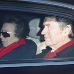 Princess Anne and her husband Vice Admiral Sir Timothy Lawrence dressed in dark coats and red scarves as they arrived