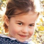 Princess Charlotte wearing a navy blue cardigan that belonged to George