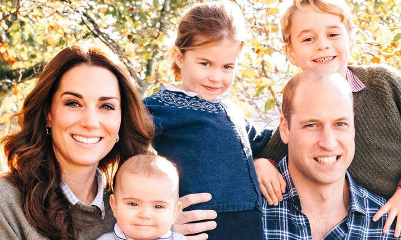 Princess Charlotte wears Prince George's hand me down in Christmas family photo Photo C GETTY
