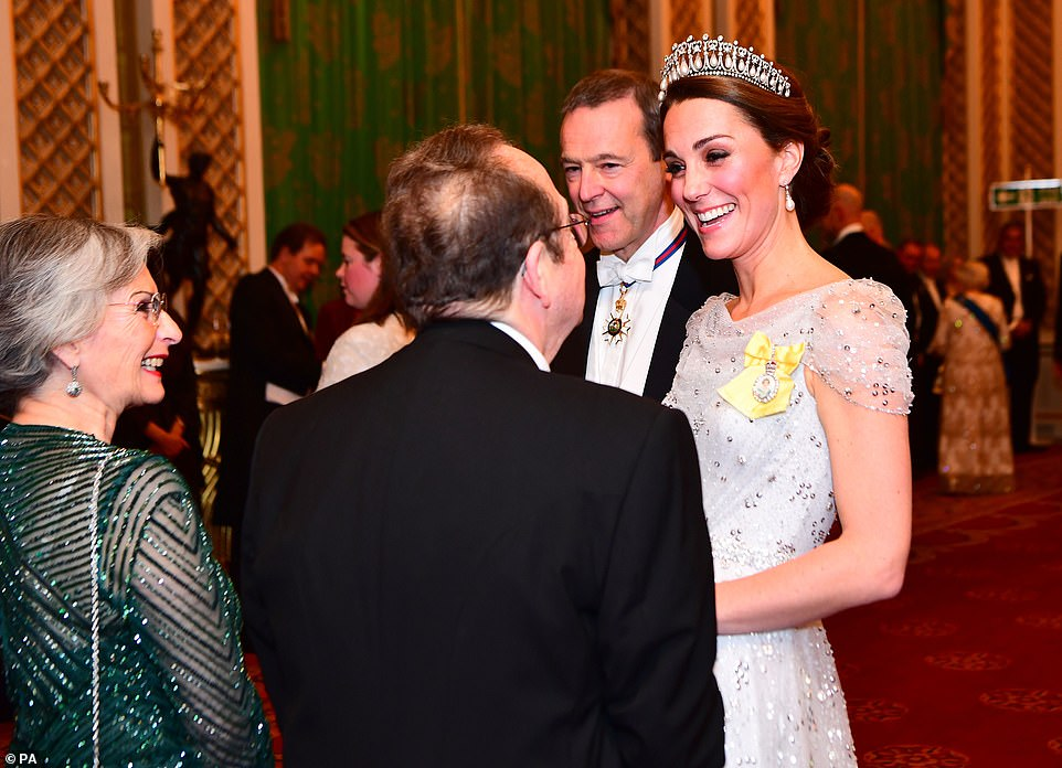 Radiant Kate appeared perfectly charming as she spoke to guests ahead of the lavish meal at the palace on Tuesday
