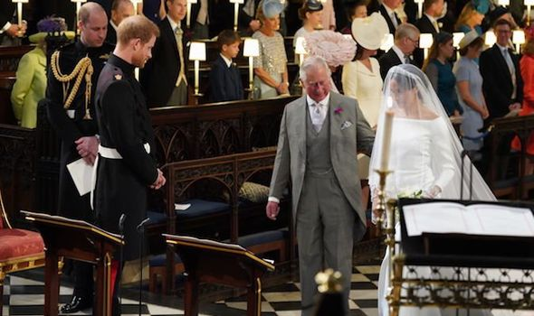 Royal news The moment Charles walks Meghan down the aisle to his son Prince Harry Image GETTY