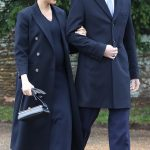 The Duchess and Harry linked arms as they made their way back to Sandringham House