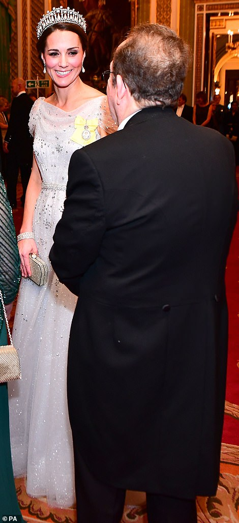 The Duchess embellished dress glimmered beneath the soft lights of the Buckingham Palace room where guests mingled