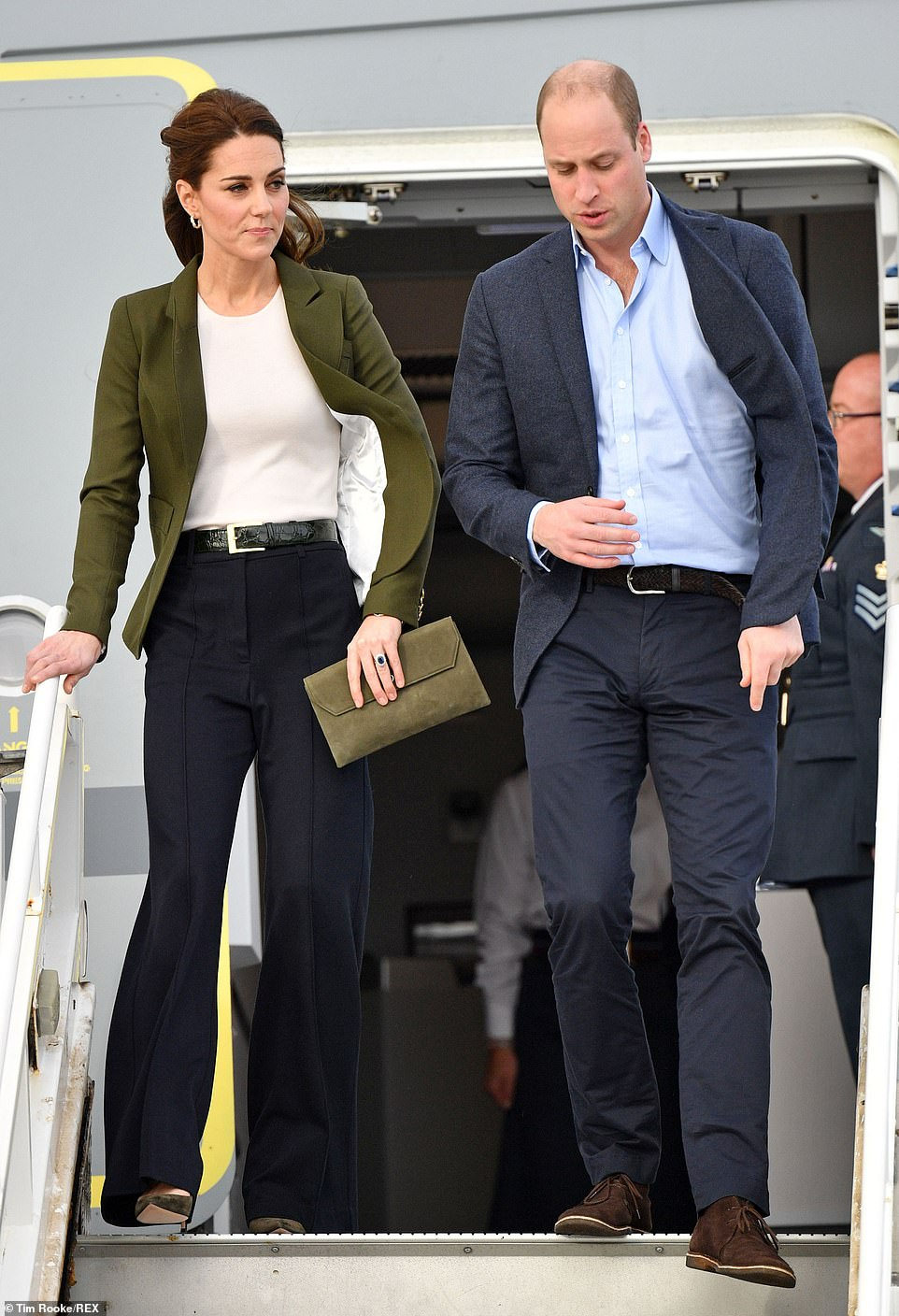The Duchess looked impeccably co ordinated matching her khaki suede clutch bag and shoes to her blazer