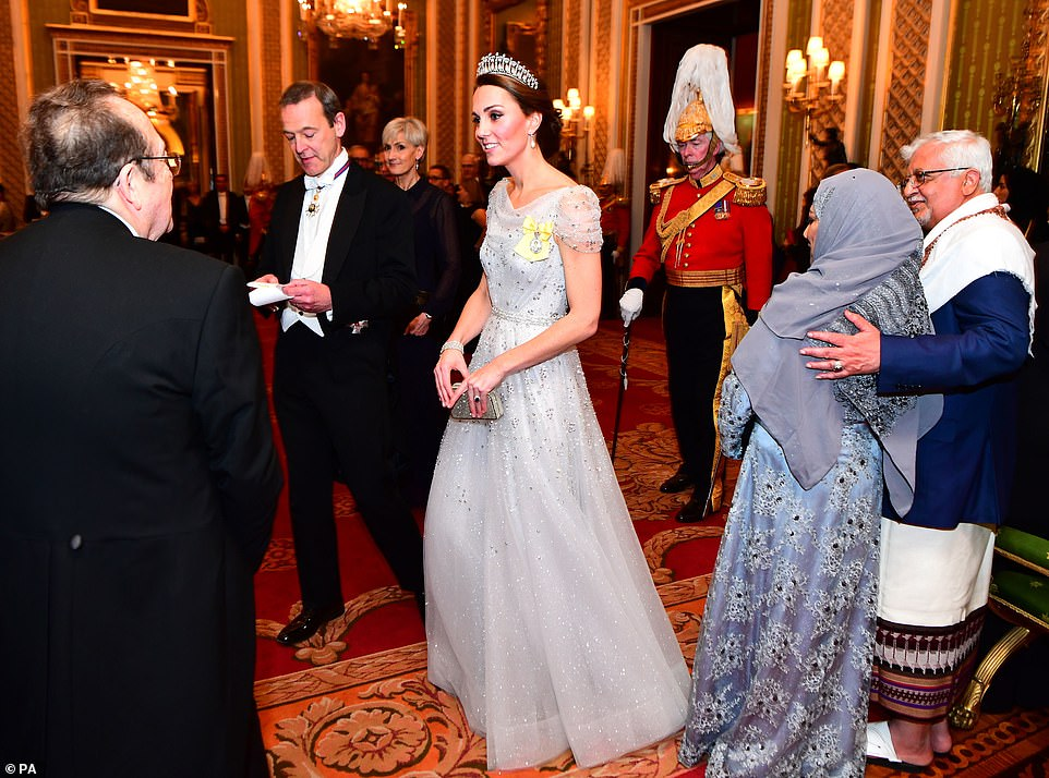 The Duchess of Cambridge 36 glittered in an embellished gown as she joined husband Prince William 36 the Queen 92 and the Duke and Duchess of Cornwall