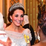 The Duchess of Cambridge accessorised with a favourite pair of pearl drop earrings and proudly wore the yellow ribbon of the Queens Royal Order pinned to her chest