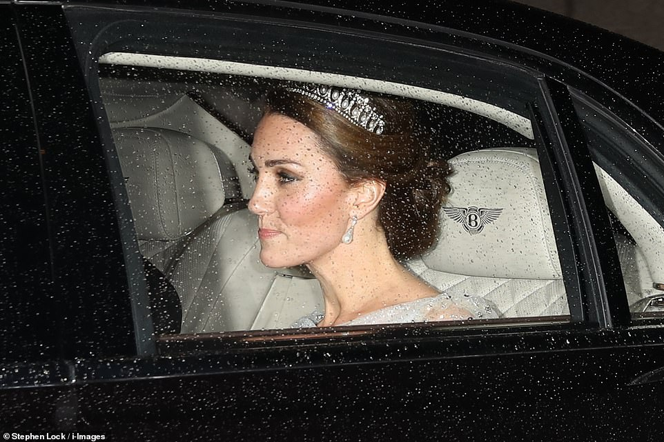 The Duchess of Cambridge dazzled in a tiara that once belonged to Princess Diana as she arrived for a glittering Buckingham Palace reception on Tuesday night