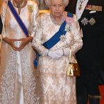 The Duchess of Cornwall was resplendent in an oyster coloured satin evening coat left which she wore over a floor length gown