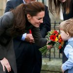 The Duchess showed off her maternal side as she met a young boy while visiting the GISDA centre in Wales Photo C GETTY