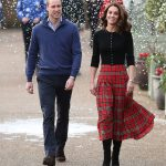 The Duke and Duchess of Cambridge arrive at Kensington Palace yesterday to host a Christmas party