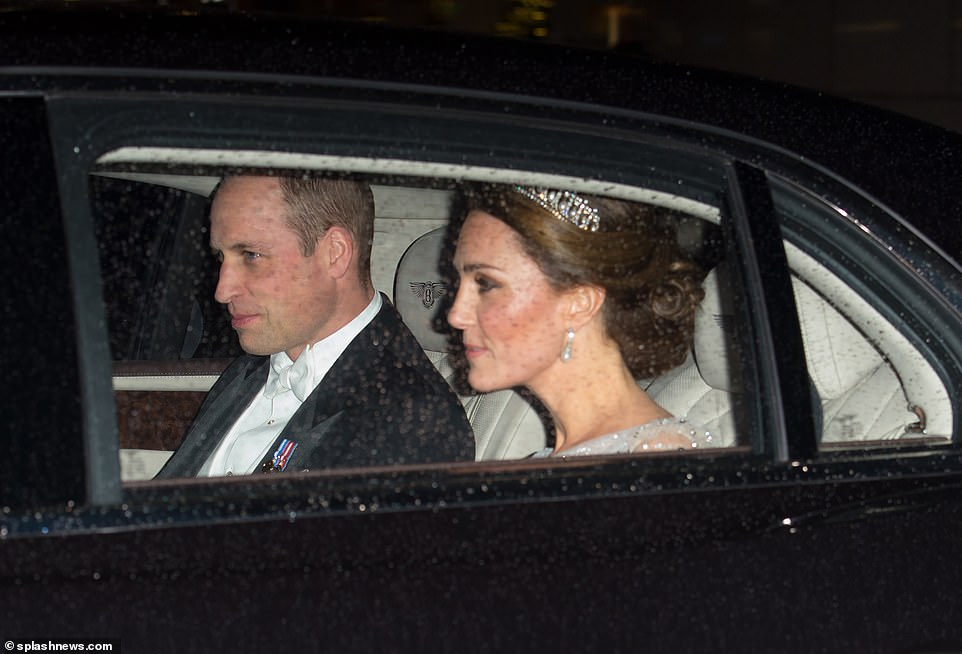 The Duke and Duchess of Cambridge arrived at Buckingham Palace together in the back of a chauffeur driven Bentley