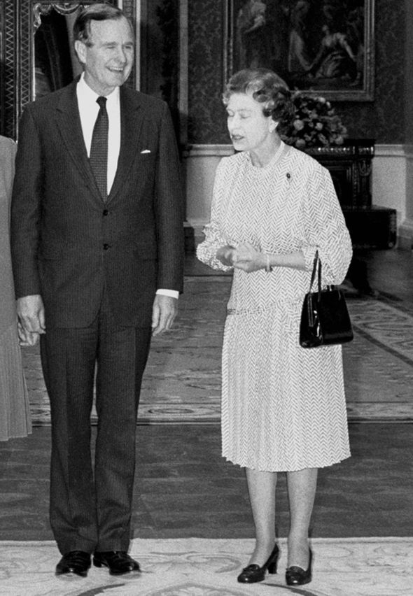 The Queen and George HW Bush in the Picture Room at Buckingham Palace Image PA
