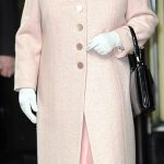 The Queen is devoted to her Launer handbags and has been carrying the same style for years allowing her to keep her hands free to greet people and accept flowers