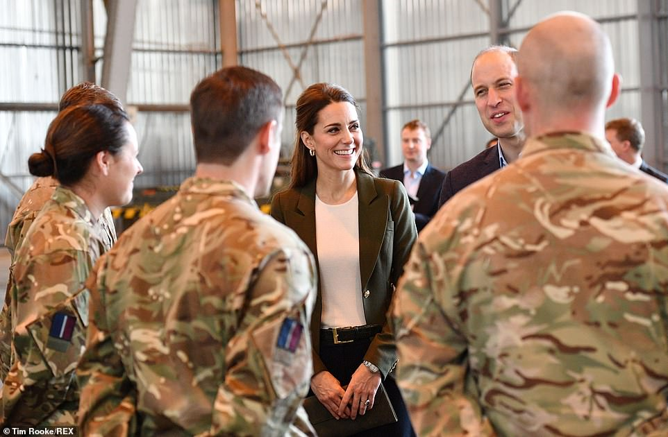 The couple had a short private briefing before going to a hangar to meet with some of the servicemen and women on the base
