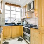 The flats kitchen is neat and tidy Image RIGHT MOVE