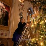 The tree decorated with golden baubles pine cones hundreds of lights Image PA
