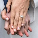 They both appear to play with their rings Image GETTY
