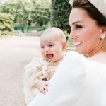 ouis christening took place in July with the baby being just three months old at the time the adorable portraits captured the smiling tot in the arms of his adoring mother