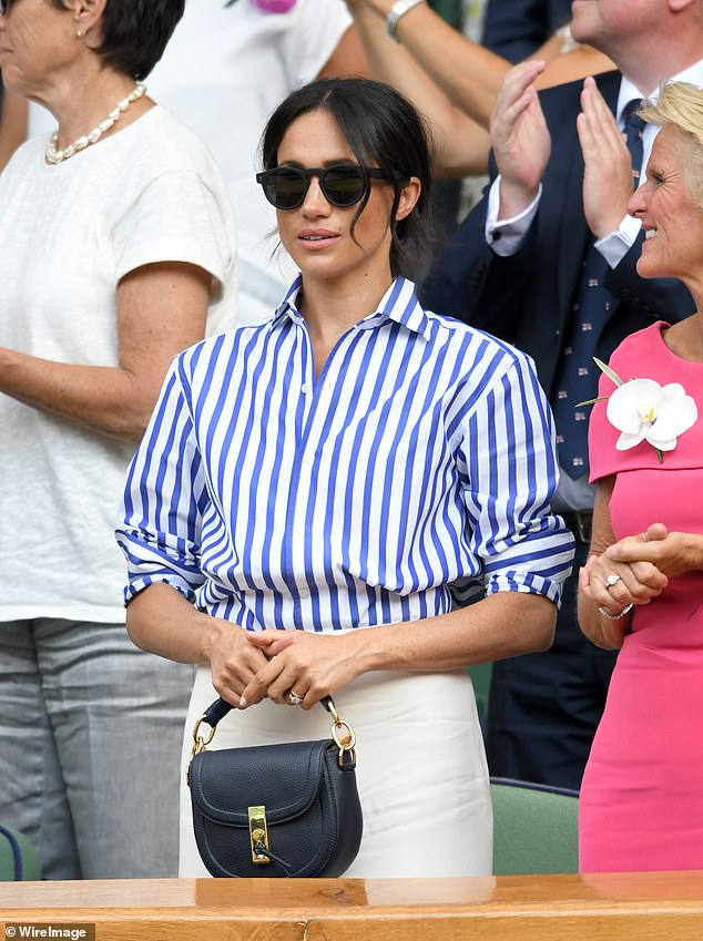 Here the duchess is seen in July as she attended the Wimbledon Tennis Championships carrying the Altuzarra black Ghianda Saddle bag retailing at £1 260