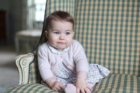 Inside Anmer Hall Princess Charlotte sat on a green checked chair in one snap Image GETTY