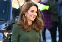 Kate Middleton wows in racing green dress coat with a mock croc twist Photo C Getty Images