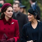 Kate and Meghan smile together on the Christmas Day walk to church Image Getty