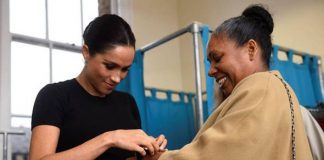 Meghan Markle puts a bracelet on Patsy Wardally during her visit to Smart Works Image PA