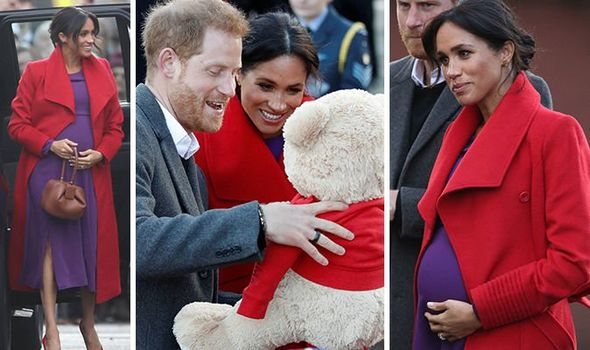Meghan glowed in a red coat and purple dress Image PA