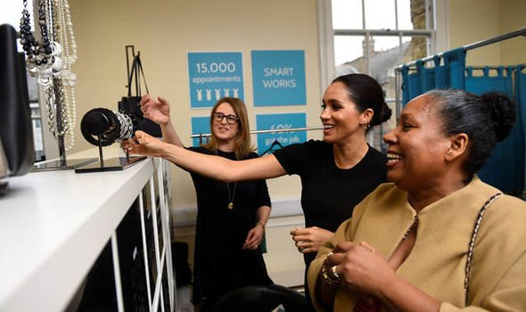 Meghan the Duchess of Sussex picks out clothes with Patsy Wardally during her visit at Smart Works Image REUTERS