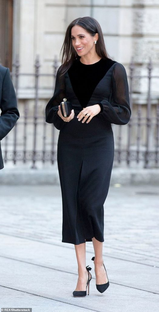 Once again revealing her eye for Givenchy Meghan carried their Black Satin Clutch costing £1 500
