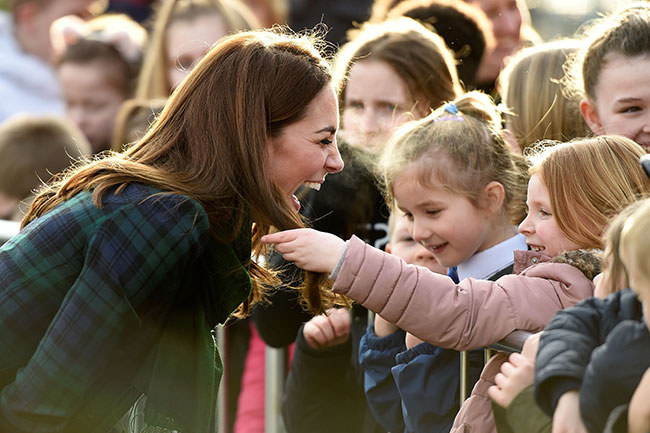 Watch the sweet moment adorable girl strokes Kate Middletons hair Photo C GETTY IMAGES