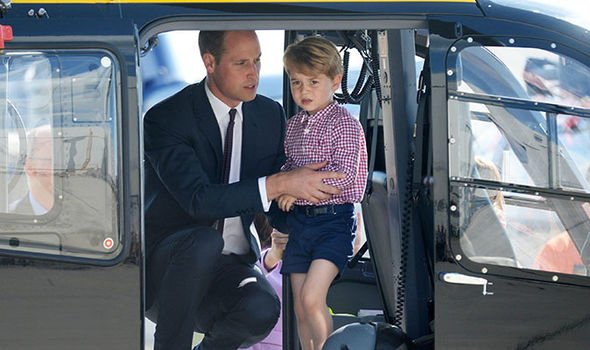 Prince William shows his son Prince George a helicopter cockpit in Germany Image Getty