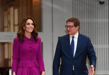 The Duchess was in high spirits as she arrived at the central London venue She looked classically elegant in a purple Oscar de la Renta skirt suit Photo C PA
