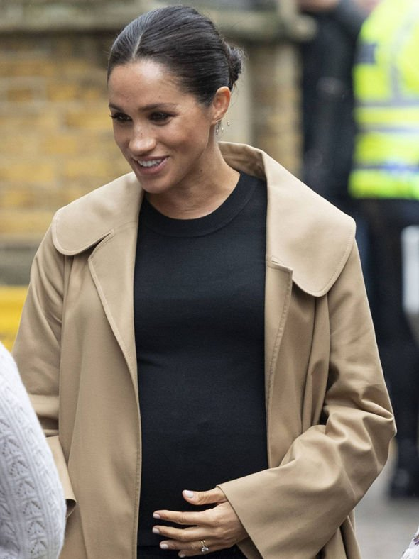 The Duchess was spotted touching her bump during her Smart Works visit Image GETTY