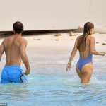 The couple could then be seen heading back to the shore where they dried off in the Carribean sun
